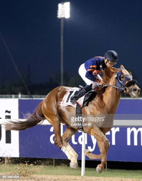 Jockey Joel Rosario rides Mind Your Biscuits to win the Dubai Golden Shaheen at the Dubai World Cup in the Meydan Racecourse on March 25 2017 in...