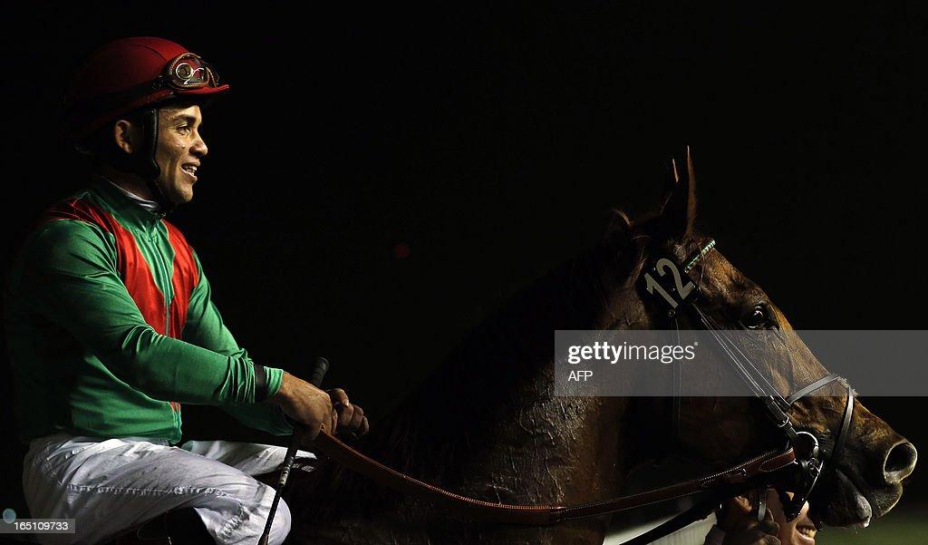 Jockey Joel Rosario smiles after leading Animal Kingdom to win the 10 million US dollar Dubai World Cup, the world's richest race, at Meydan race track in Dubai on March 30, 2013.
