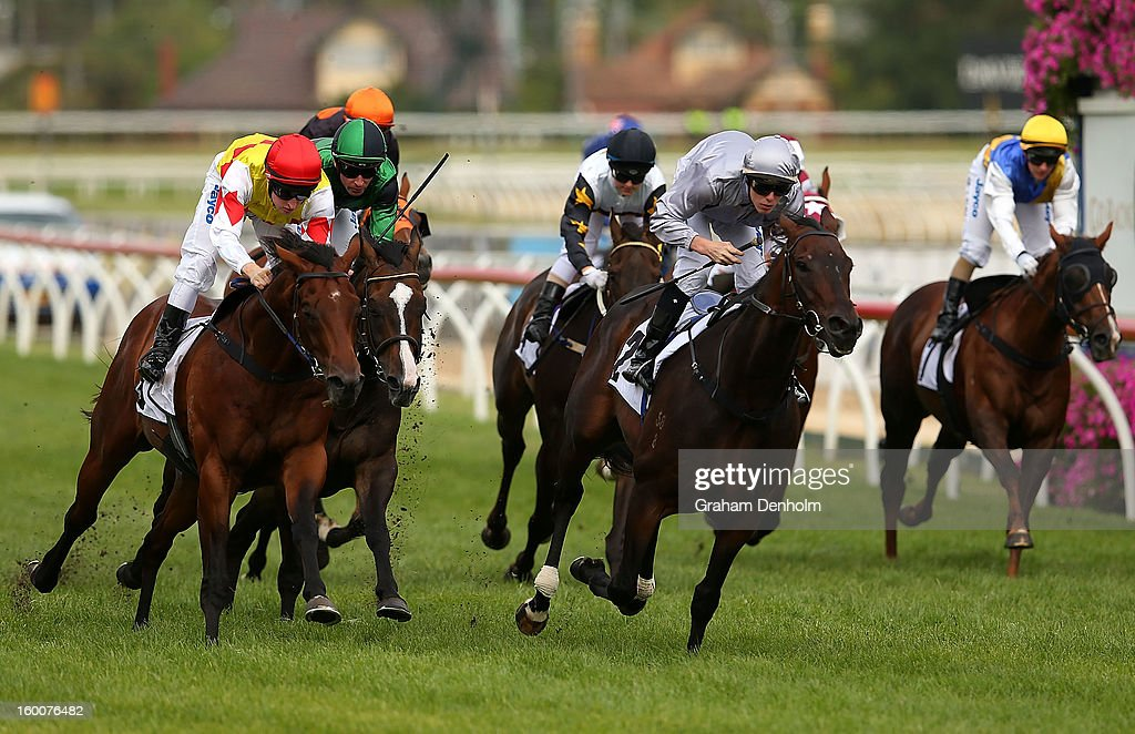 Jockey John Kissick (C) riding Rescue Mission leads the field to win race seven the BMW Handicap during Australia Day Races at Caulfield Racecourse on January 26, 2013 in Melbourne, Australia.