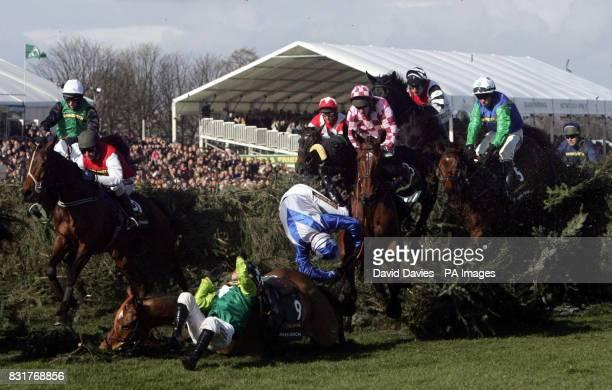 Jockey John McNamara falls from Heros Collonges and Sam Thomas falls from Silver Birch at the Chair during the John Smith's Grand National at Aintree...