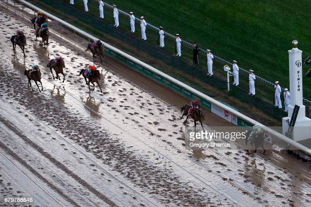 Jockey John Velazquez celebrates as he guides Always Dreaming across the finish line to win the 143rd running of the Kentucky Derby at Churchill...