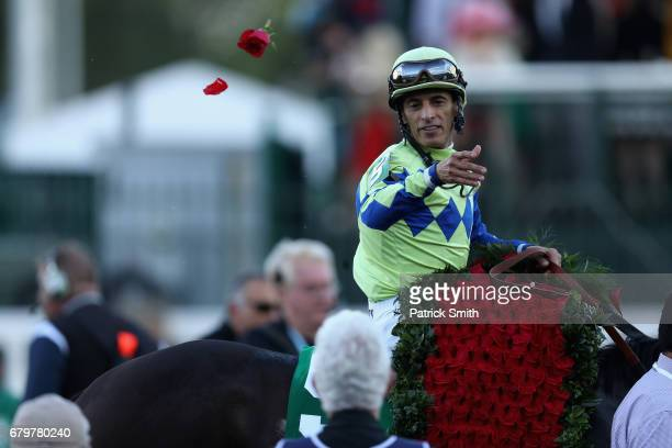 Jockey John Velazquez celebrates atop Always Dreaming after winning the 143rd running of the Kentucky Derby at Churchill Downs on May 6 2017 in...
