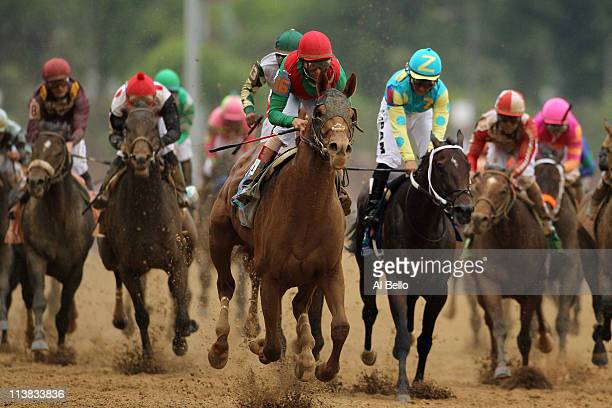 Jockey John Velazquez riding Animal Kingdom runs down the front stretch towards the finish line to win the 137th Kentucky Derby at Churchill Downs on...