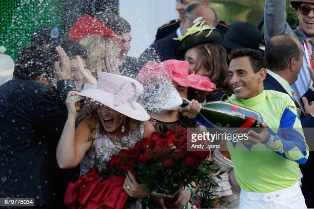 Jockey John Velazquez sprays champagne in the winner's circle after guiding Always Dreaming to win the 143rd running of the Kentucky Derby at...