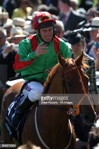 Jockey Johnny Murtagh celebrates on Dancing Rain after winning the Investec Oaks during Ladies Day at the Investec Derby Festival Epsom Downs...