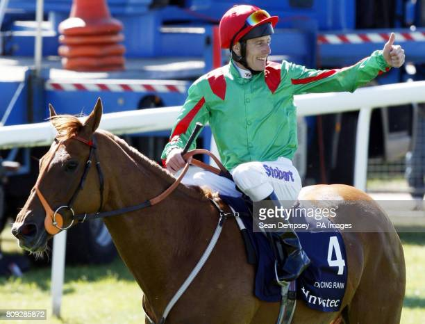 Jockey Johnny Murtagh celebrates winning on Dancing Rain in the Investec Oaks during Ladies Day at the Investec Derby Festival Epsom Downs Racecourse