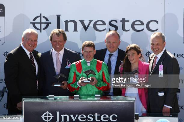 Jockey Johnny Murtagh celebrates with his trophy after winning the Investec Oaks on Dancing Rain during Ladies Day at the Investec Derby Festival...