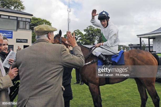 Jockey Johnny Murtagh celebrates with trainer John Hayden after crossing the line on Emily Blake to win the TRI Equestrian Stakes during the...