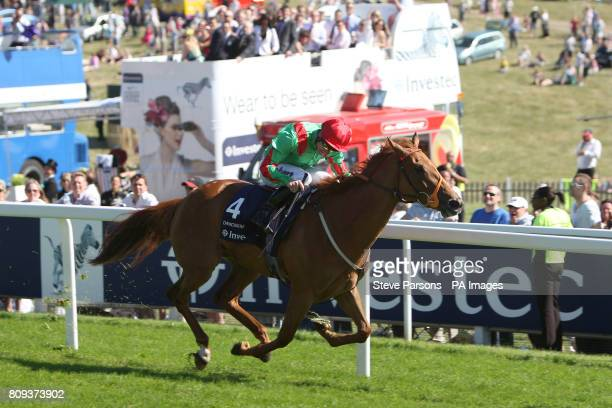 Jockey Johnny Murtagh on Dancing Rain wins the Investec Oaks during Ladies Day at the Investec Derby Festival Epsom Downs Racecourse Surrey