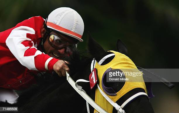 Jockey Jon Court urges Film Fortune into the final turn during the 61st running of the Oceanside Stakes 1 Mile Turf on July 19 2006 at Del Mar...
