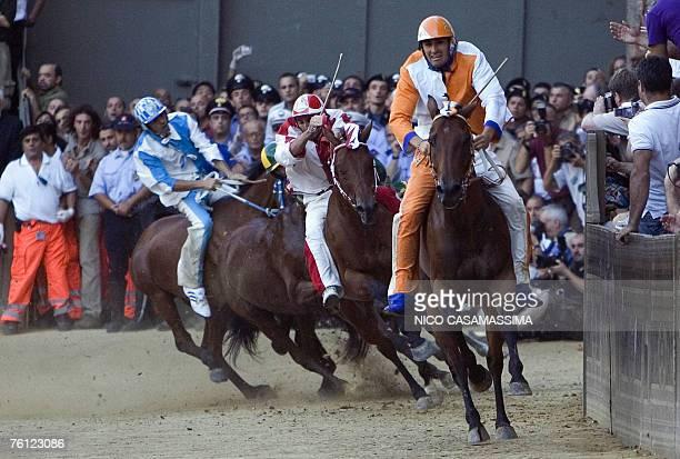 Jockey Jonathan Bartoletti named Scompiglio of Leocorno parish leads to win the Palio horse race at the Casato curve in the Piazza del Campo in Siena...