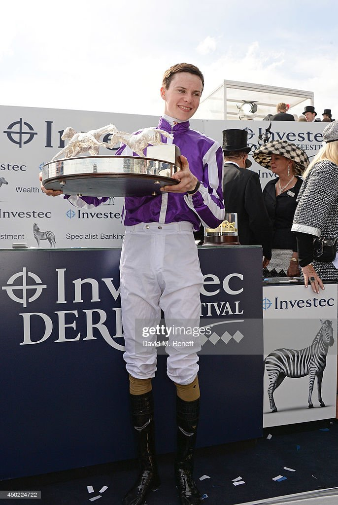 Jockey Joseph O'Brien celebrates Australia's win of the Investec Derby during Derby Day at the Investec Derby Festival at Epsom Downs Racecourse on June 6, 2014 in Epsom, England.