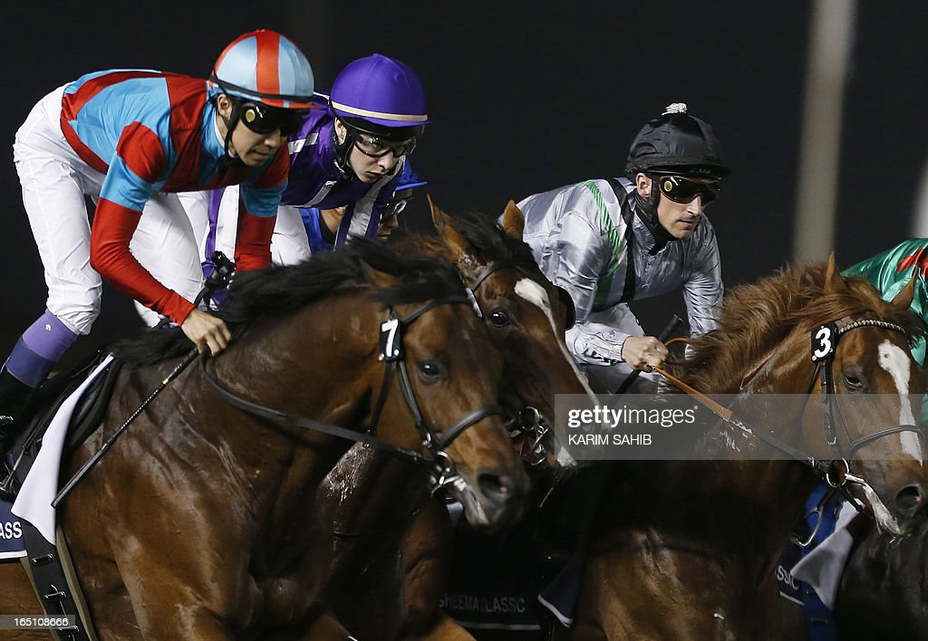 Jockey Joseph O'Brien (C) on St. Nicholas Abbey, rides to win the Dubai Sheema Classic part of the Dubai World Cup meet, the world's richest race, at Meydan race track in Dubai on March 30, 2013. AFP PHOTO/KARIM SAHIB