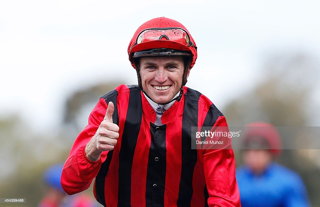 Jockey Joshua Parr reacts after winning Race 6 'MTA NSW Run to the Rose' during Sydney Racing at Rosehill Gardens on August 30, 2014 in Sydney, Australia.