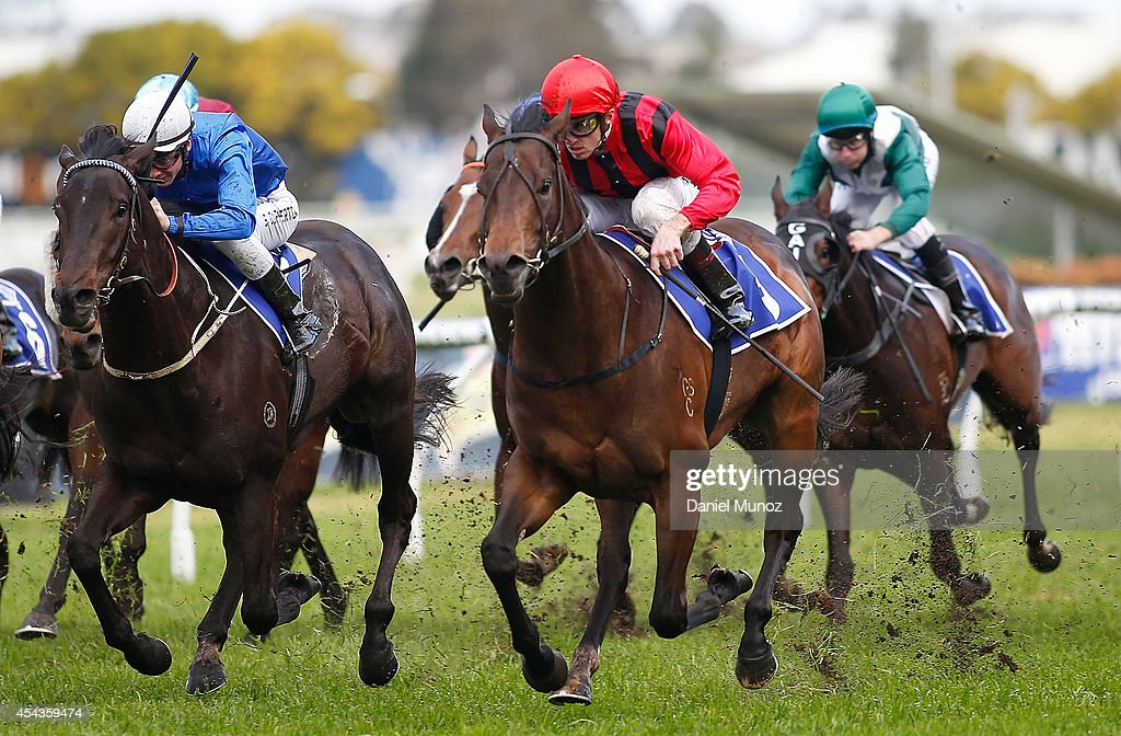 Jockey Joshua Parr (centre) rides Hallowed Crown to win Race 6 'MTA NSW Run to the Rose' during Sydney Racing at Rosehill Gardens on August 30, 2014 in Sydney, Australia.
