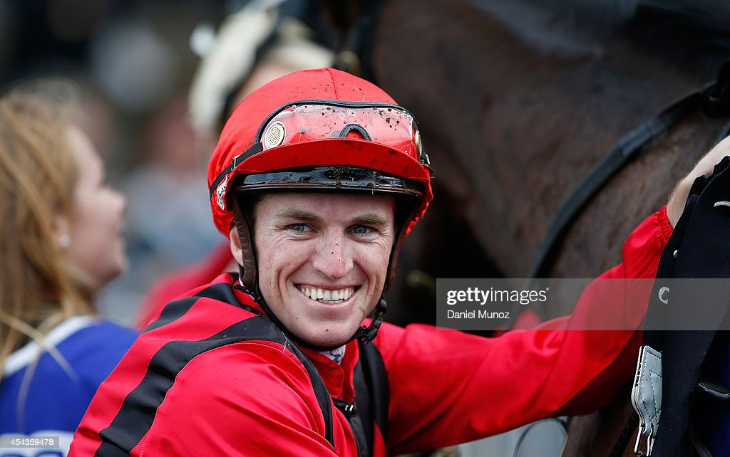 Jockey Joshua Parr smiles after winning Race 6 'MTA NSW Run to the Rose' during Sydney Racing at Rosehill Gardens on August 30, 2014 in Sydney, Australia.
