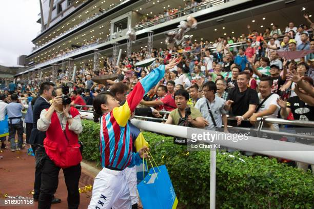 Jockey Kei Chiong Kakei hand out gifts to thank all racing fans for their support during the season at Sha Tin racecourse on July 16 2017 in Hong...