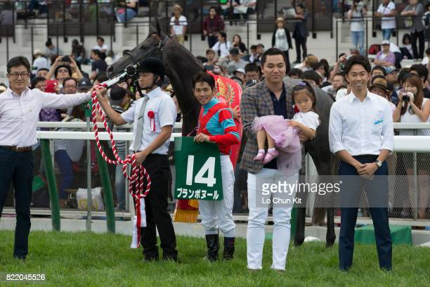 Jockey Keita Tosaki and owners celebrate after Blanc Bonheur wins the Race 11 Keeneland Cup at the Sapporo Racecourse on August 28 2016 in Sapporo...