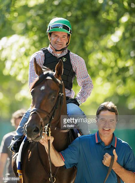 Jockey Kent Desormeaux and trainer Keith Desormeaux take Exaggerator onto the track before a training session prior to the 148th running of the...