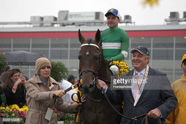 Jockey Kent Desormeaux raises the Woodlawn Vase after Exaggerator wins the Preakness Stakes on May 21 2016 at Pimlico Race Course Baltimore