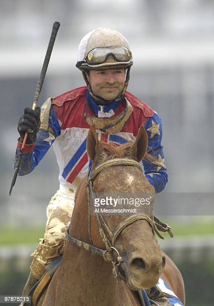Jockey Kent Desormeaux rides Japengo to a victory in the muddy seventh race at Churchill Downs May 3 2007 in Louisville Kentucky