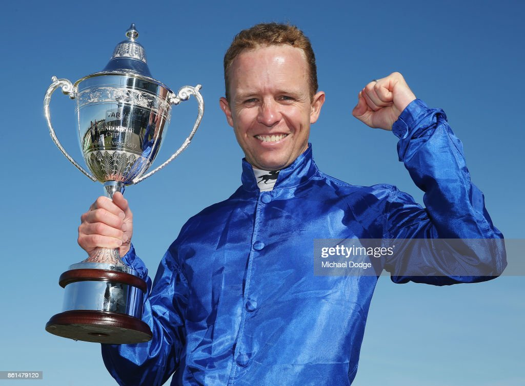 Jockey Kerrin McEvoy poses with his trophy after riding Folkswood to win race 8 the TAB Cranbourne Cup during Cranbourne Cup Day at on October 15, 2017 in Cranbourne, Australia.