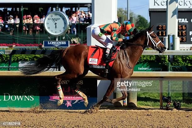 Jockey Kerwin D Clark celebrates atop Lovely Maria after crossing the finish line to win the 141st running of the Kentucky Oaks at Churchill Downs at...