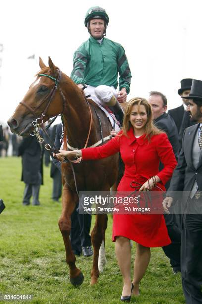 Jockey Kevin Manning on New Approach is lead into the winner's enclosure by Princess Haya of Jordan after winning The Vodafone Derby at Epsom Downs...