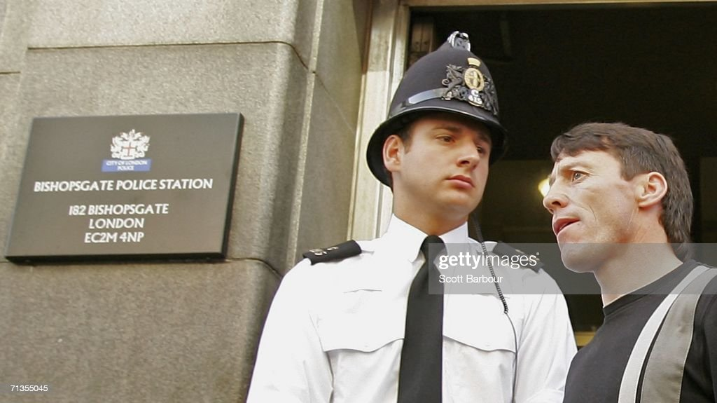 Jockey Kieren Fallon is watched by a police officer as he leaves Bishopsgate police station on July 3 2006 in London England Fallon was one of 28...