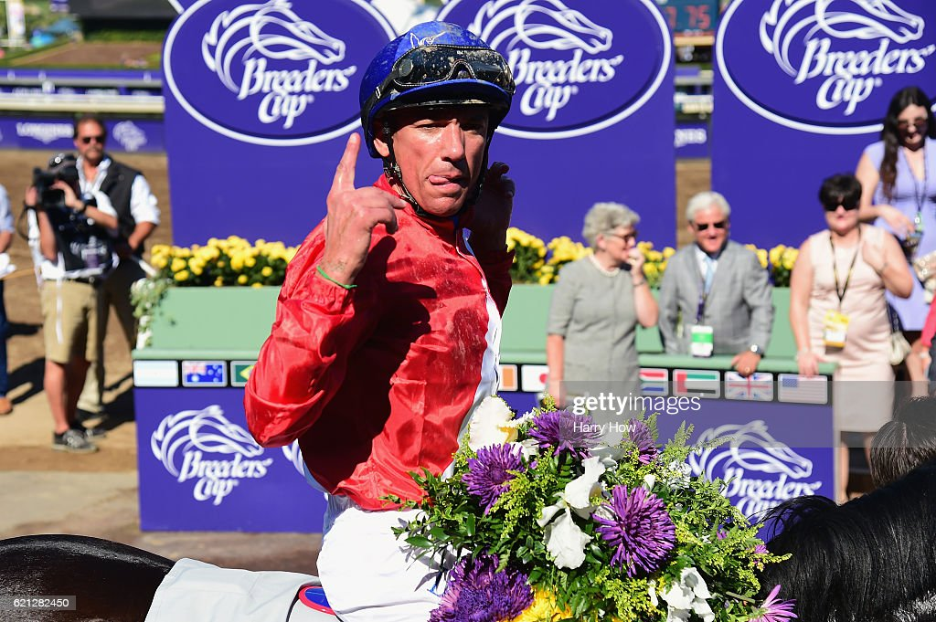 Jockey Lanfranco Dettori riding Queen's Trust celebrates after winning the Filly & Mare Turf race on day two of the 2016 Breeders' Cup World Championships at Santa Anita Park on November 5, 2016 in Arcadia, California.