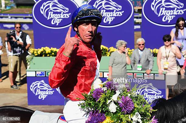 Jockey Lanfranco Dettori riding Queen's Trust celebrates after winning the Filly Mare Turf race on day two of the 2016 Breeders' Cup World...