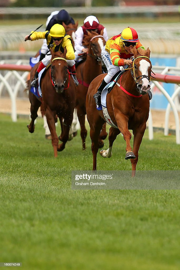 Jockey Lauren Stojakovic (R) riding Miracles of Life wins race four the Patinack Farm Blue Diamond Preview during Australia Day Races at Caulfield Racecourse on January 26, 2013 in Melbourne, Australia.