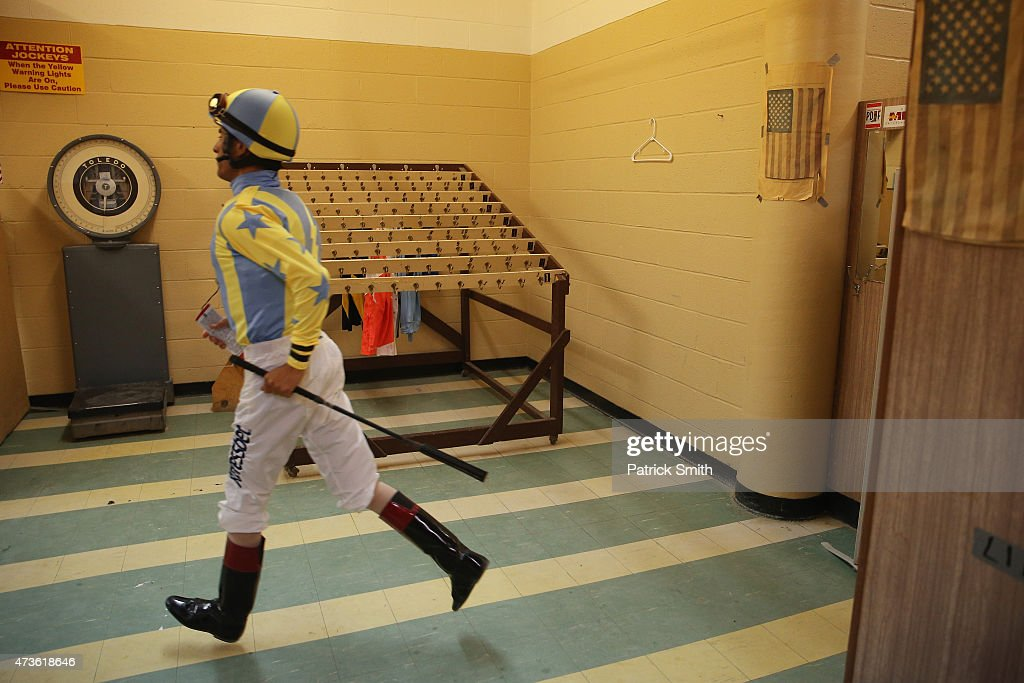 A jockey leaves the locker room for a race prior to the 140th running of the Preakness Stakes at Pimlico Race Course on May 16 2015 in Baltimore...