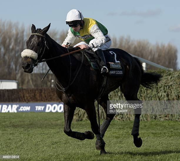 Jockey Leighton Aspell riding 'Many Clouds' crosses the final fence to win the Grand National race on the final day of the Grand National Festival...