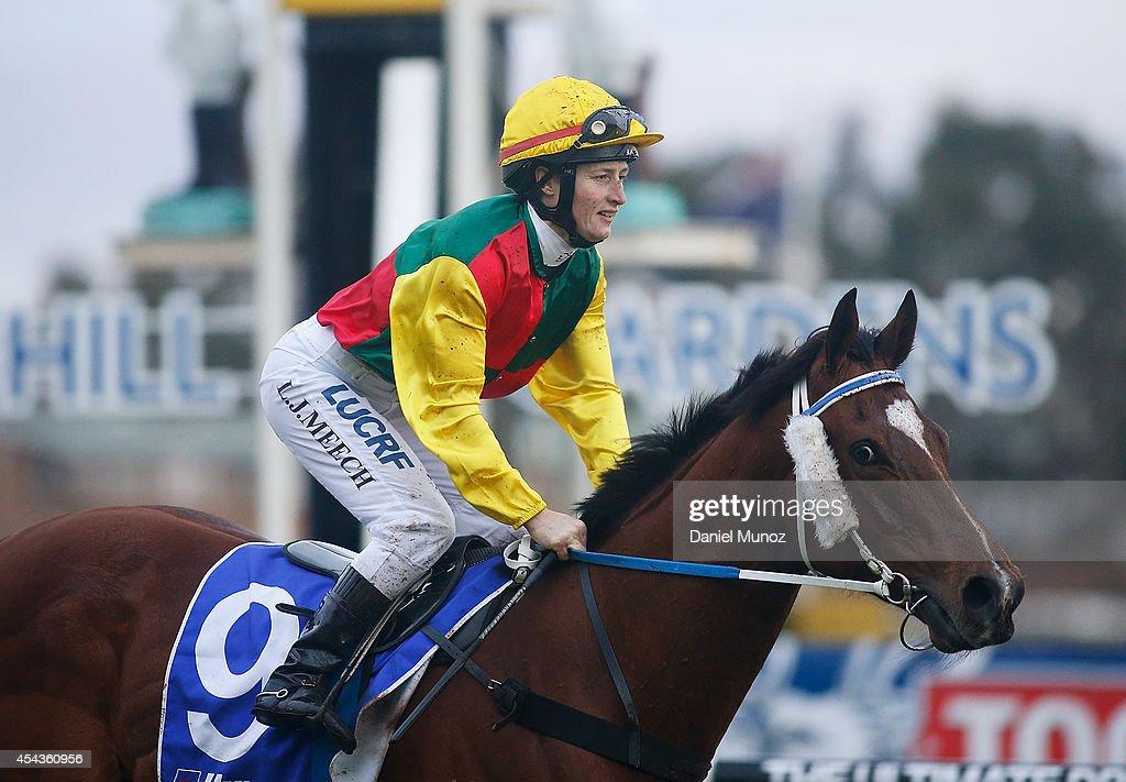 Jockey Linda Meech riding Weinholt reacts after winning Race 8 'Hyland Race Colours Handicap' during Sydney Racing at Rosehill Gardens on August 30, 2014 in Sydney, Australia.