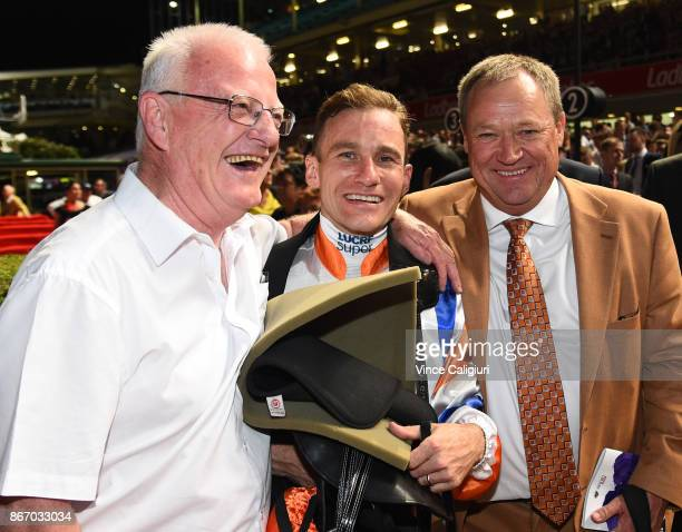 Jockey Luke Currie and trainer Tony McEvoy are all smiles after Hey Doc won Race 7 Ladbrokes Manikato Stakes during Manikato Stakes Night at Moonee...