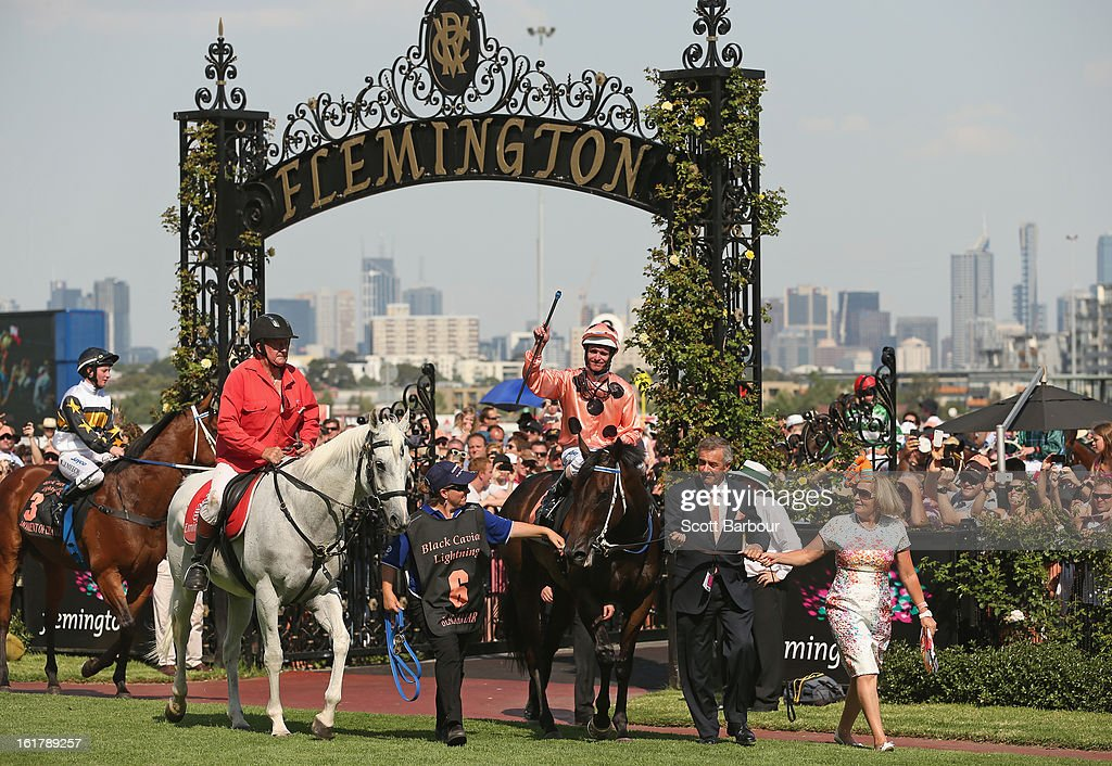 Jockey Luke Nolen gestures after riding Black Caviar for her 23rd consecutive win in race 7 the Black Caviar Lightning Stakes during Lightning Stakes Day at Flemington Racecourse on February 16, 2013 in Melbourne, Australia.