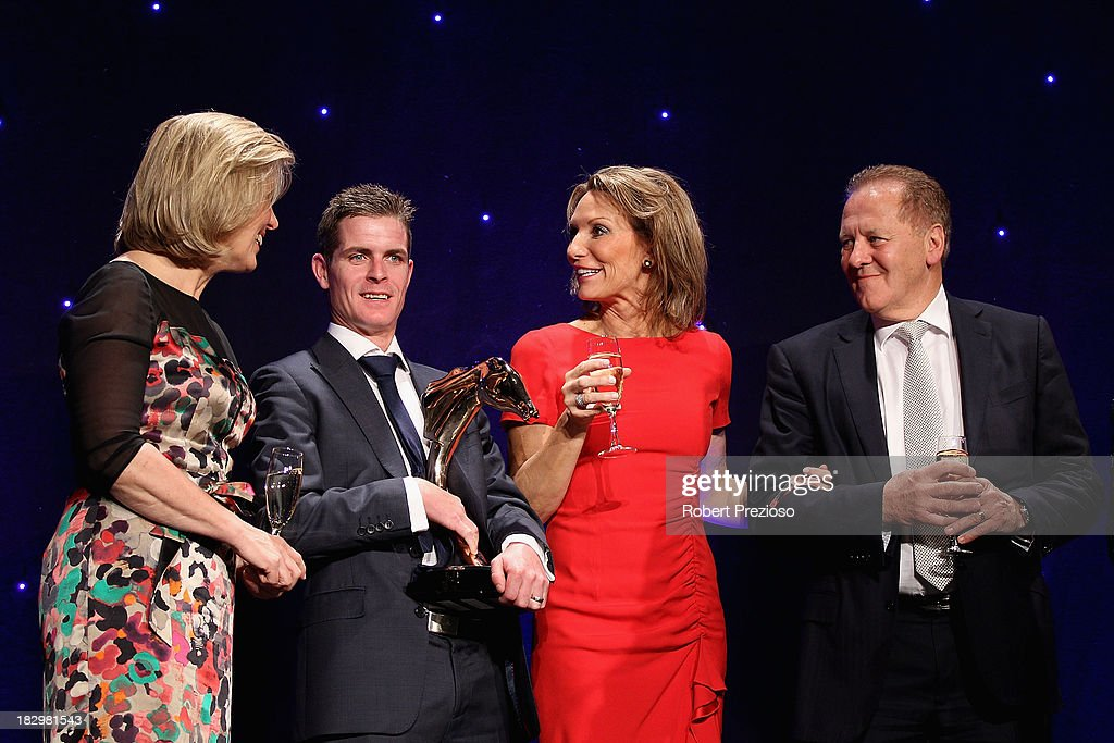 Jockey <a gi-track='captionPersonalityLinkClicked' href=/galleries/search?phrase=Luke+Nolen&family=editorial&specificpeople=2190756 ng-click='$event.stopPropagation()'>Luke Nolen</a> holds the award along with connections after receiving the award for Australian Racehorse of the year with racehorse Black Caviar during the Australian Racehorse of the Year Awards at Peninsula on October 3, 2013 in Melbourne, Australia.