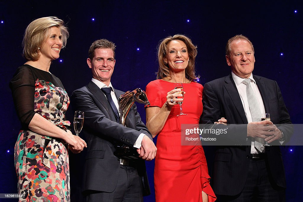 Jockey Luke Nolen holds the award along with connections after receiving the award for Australian Racehorse of the year with racehorse Black Caviar during the Australian Racehorse of the Year Awards at Peninsula on October 3, 2013 in Melbourne, Australia.