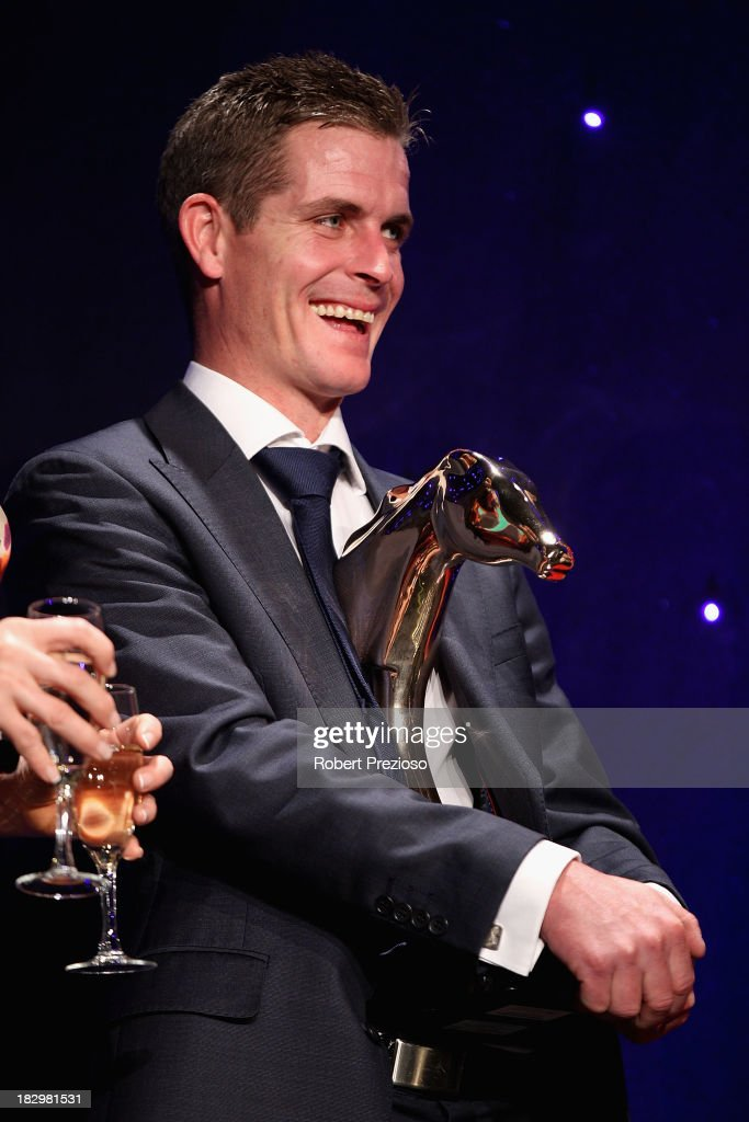 Jockey <a gi-track='captionPersonalityLinkClicked' href=/galleries/search?phrase=Luke+Nolen&family=editorial&specificpeople=2190756 ng-click='$event.stopPropagation()'>Luke Nolen</a> holds the award on behalf of connections after receiving the award for Australian Racehorse of the year with racehorse Black Caviar during the Australian Racehorse of the Year Awards at Peninsula on October 3, 2013 in Melbourne, Australia.