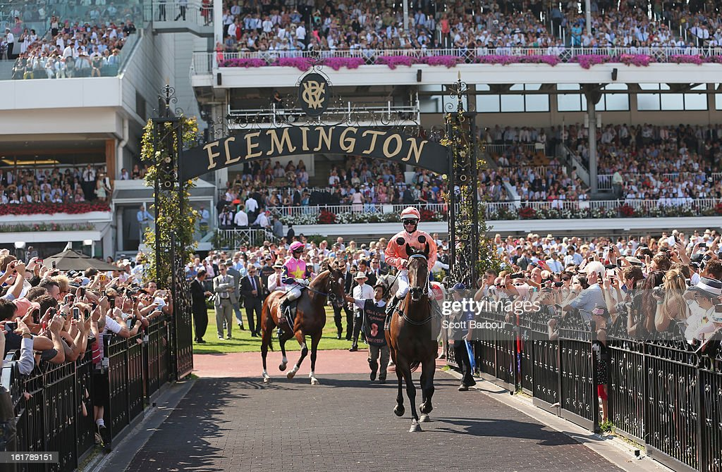 Jockey Luke Nolen rides Black Caviar out to the track before her 23rd consecutive win in race 7 the Black Caviar Lightning Stakes during Lightning Stakes Day at Flemington Racecourse on February 16, 2013 in Melbourne, Australia.