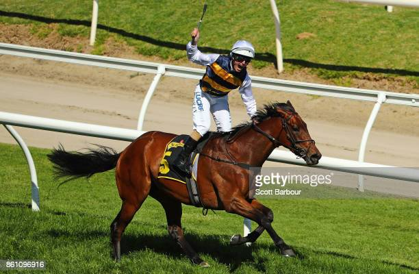 Jockey Luke Nolen riding Aloisia celebrates winning race 6 the Schweppes Thousand Guineas during Melbourne Racing on Caulfield Guineas Day at...