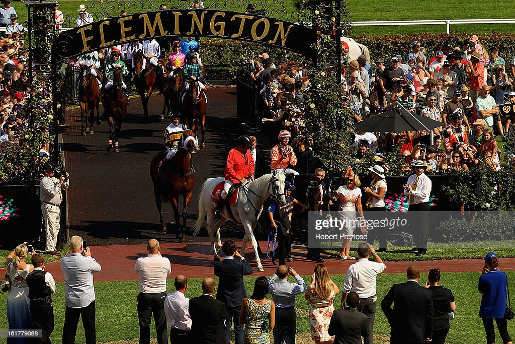 Jockey Luke Nolen riding Black Caviar returns to scale after winning her 23rd consecutive race, during Lightning Stakes Day at Flemington Racecourse on February 16, 2013 in Melbourne, Australia.