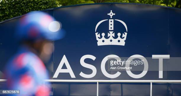 A jockey makes his way to the parade ring at Ascot Racecourse on May 13 2017 in Ascot England