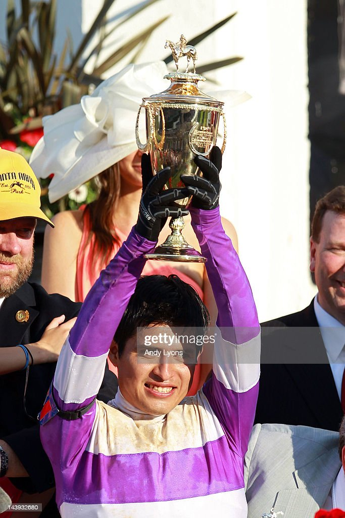 Jockey Mario Gutierrez celebrates with the trophy after riding I'll Have Another for the win at the 138th running of the Kentucky Derby at Churchill Downs on May 5, 2012 in Louisville, Kentucky.
