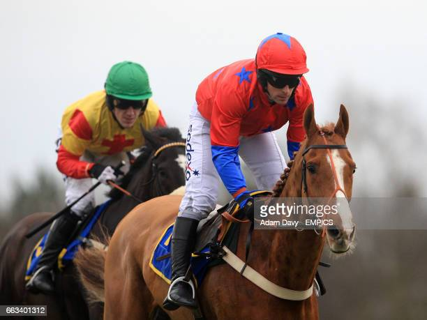 Jockey Mark Bradburne on Kingham leads Tony McCoy on Black Beauty during the Andy Don Memorial Novices' Chase