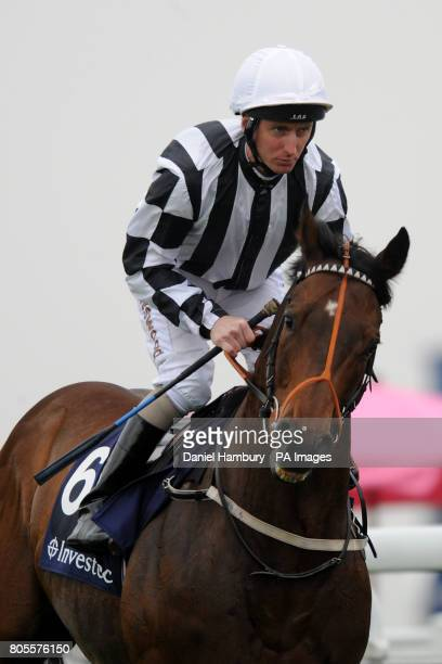Jockey Martin Dwyer on Tournedos goes to post in the Investec 'Dash'