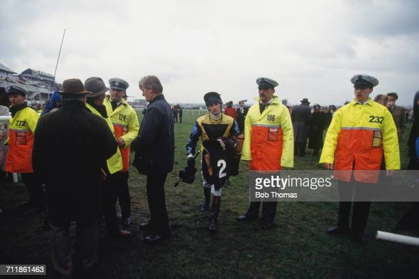 Jockey Martin Foster leaves the track after the aborted Grand National race at Aintree Racecourse Liverpool 3rd April 1993 The race was declared void...