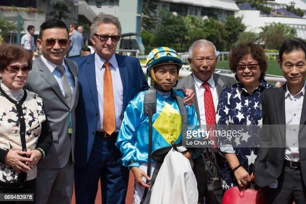 Jockey Matthew Poon Mingfai trainer David Ferraris and owners celebrate after winning Race 4 Ma Kong Shan Handicap at Sha Tin racecourse on April 17...