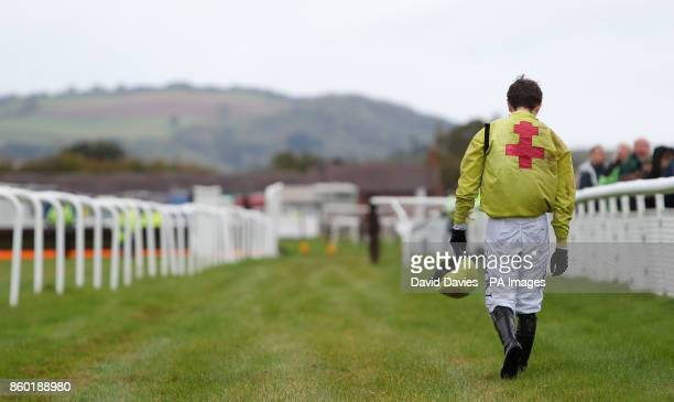 Jockey Max Kendrick makes his way back after falling in the Rowles Fine Art Handicap Chase at Ludlow Racecourse